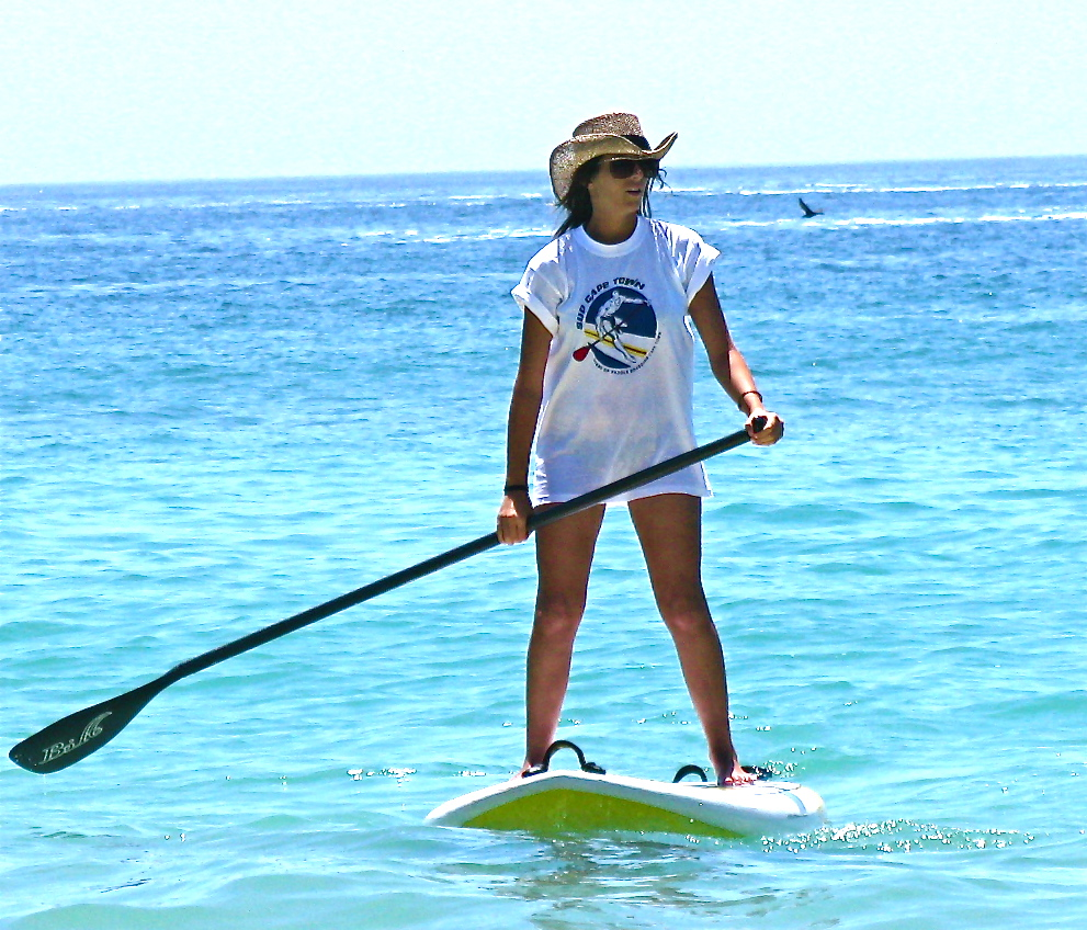 Lady on a SUP board in Cape Town South Africa