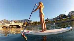 Lady doing SUP in Cape Town